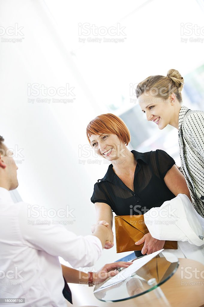 Business men shaking hands in agreement royalty-free stock photo