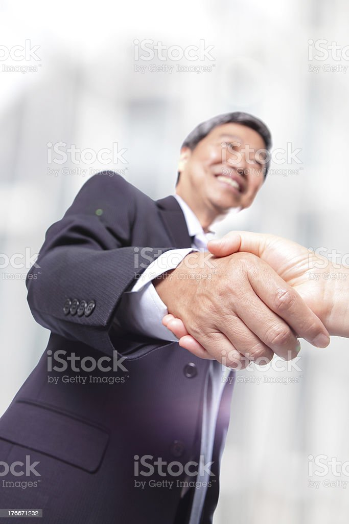 business men shaking hands in office royalty-free stock photo