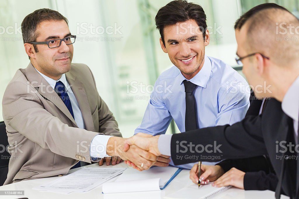 Business men shaking hands royalty-free stock photo