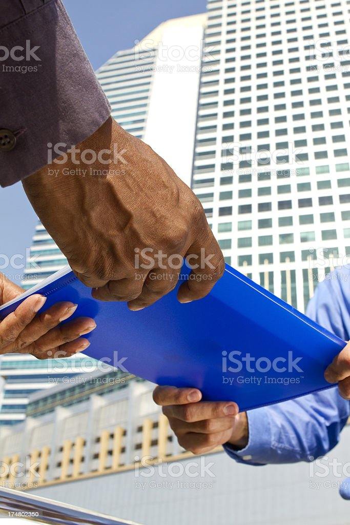 Business men submitting a file report in a financial district royalty-free stock photo