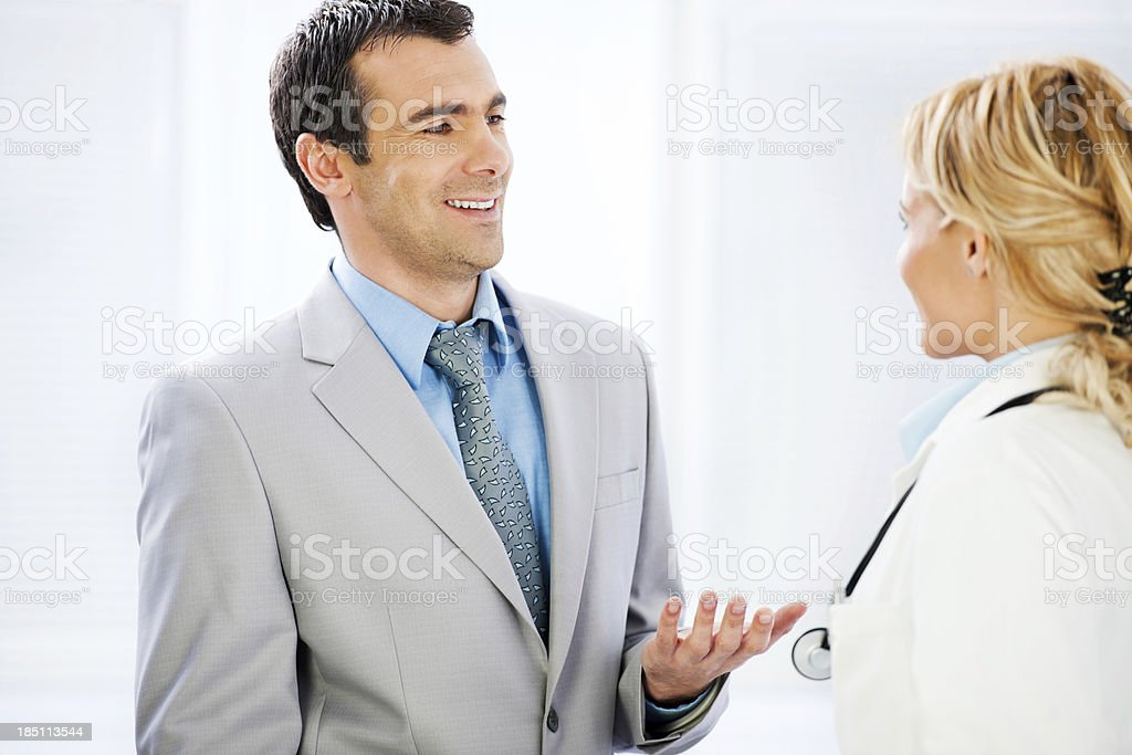 Business men talking to a female doctor. royalty-free stock photo