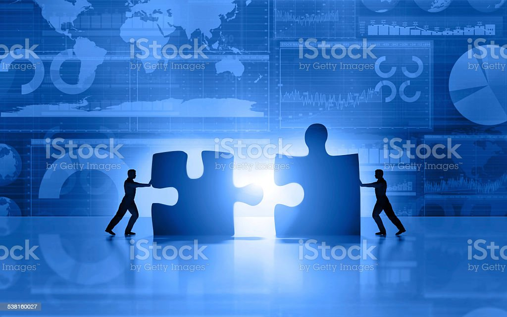 Business men teamwork joining puzzle on blue background​​​ foto