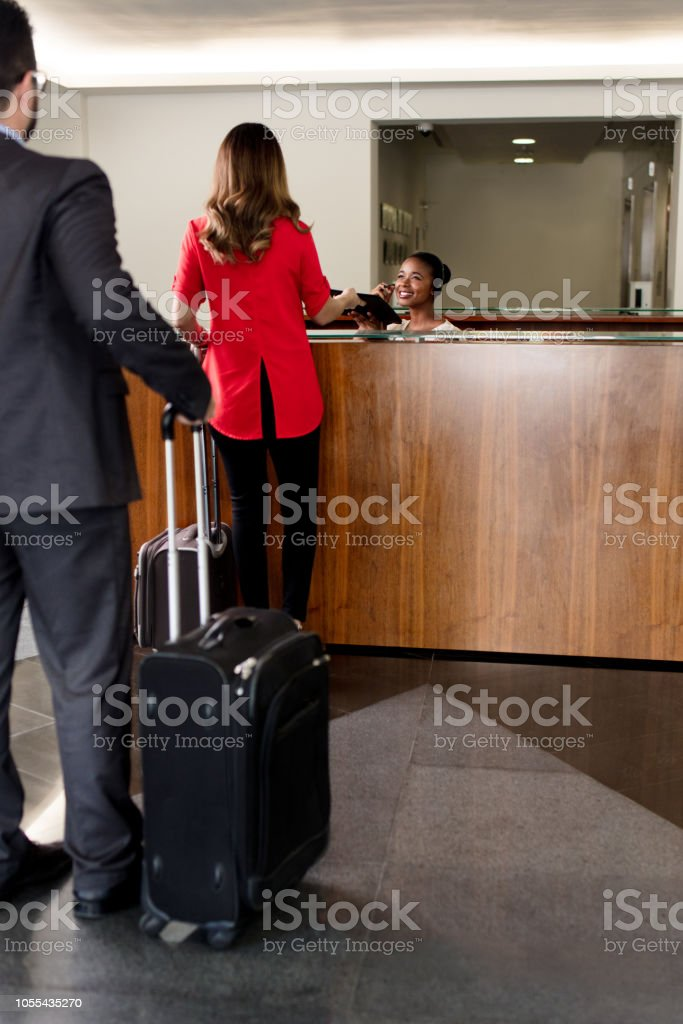 Business men waiting in line in the reception stock photo