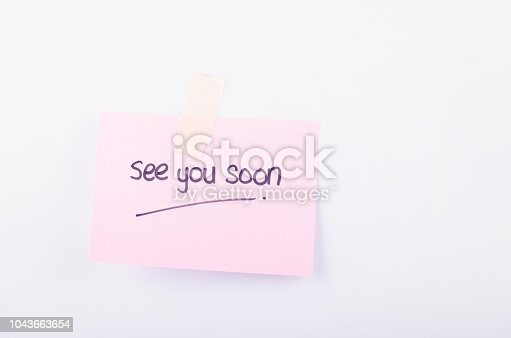 Business message See You Soon written on notepad over white background