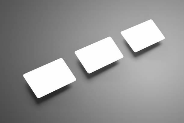 business modell von drei leere (geschenk) bankkarte mit schatten auf grauem hintergrund. - gutschein ausdrucken stock-fotos und bilder