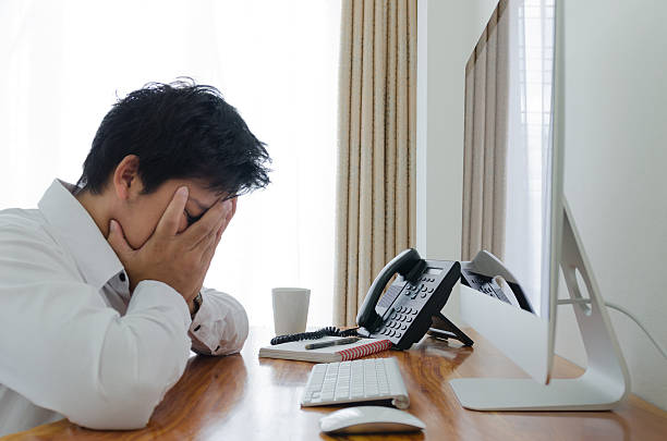 Business msn stress and sad in office stock photo