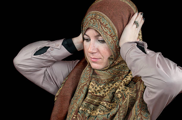 Business Muslim woman covering Islamic woman covering ears against black background hands covering ears hear no evil teenage girls women stock pictures, royalty-free photos & images