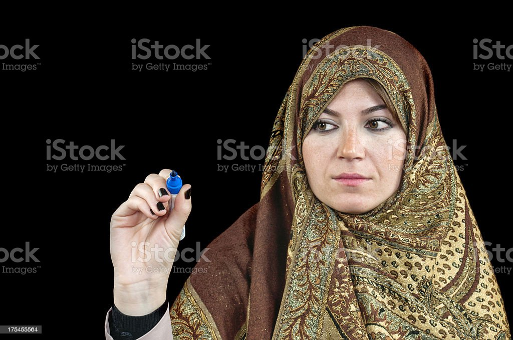 Business Muslim woman holding a marker pen in her hand royalty-free stock photo