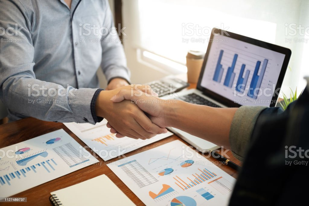 business negotiation in meeting hands shaking successful agreement