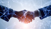 istock Business network concept. Customer support. Shaking hands. 1256603011