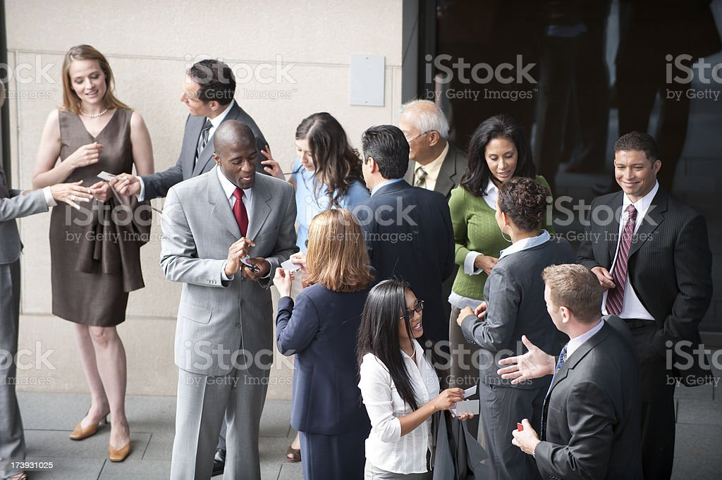 Business Networking group of business folk / all networking together / to generate cash African Ethnicity Stock Photo