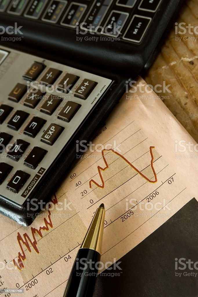 Business newspaper, pen, calculator royalty-free stock photo