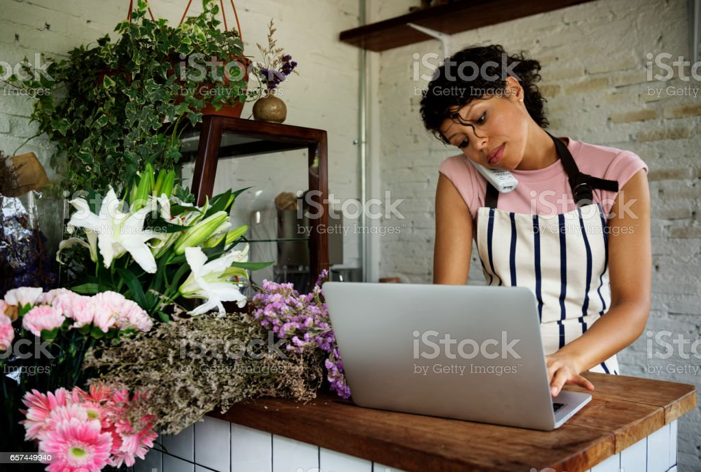 Business of flower shop with woman owner stock photo