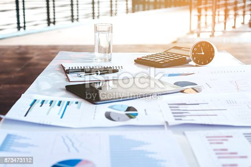 istock Business office equipment on the business paper. Report chart 873473112