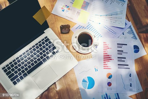 864278180istockphoto Business office equipment on the business paper. Report chart 910730724