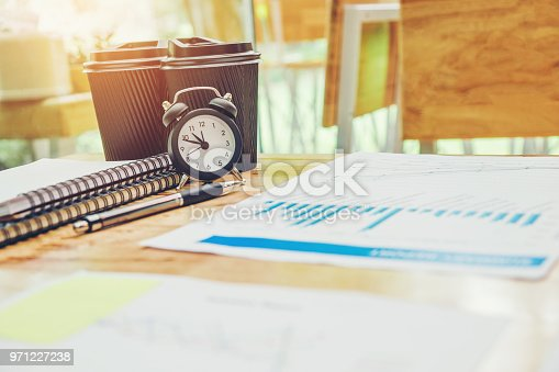 864278180istockphoto Business office equipment on the business paper. Report chart 971227238