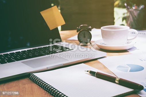 864278180istockphoto Business office equipment on the business paper. Report chart 971227266