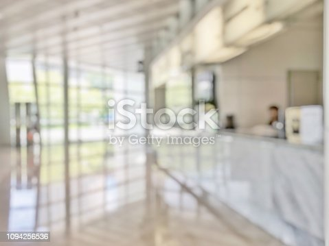 istock Business office lobby blur background of bank reception hall customer or patient counter service and cashier desk inside blurry hospital, office or hotel waiting hall with glass wall window 1094256536