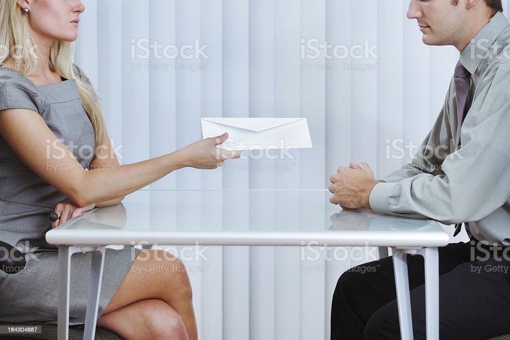 Business Office Worker Handing Out Layoff Notice in Economic Recession stock photo