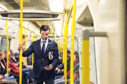Business on the go - Commuting in the morning in London in the subway train