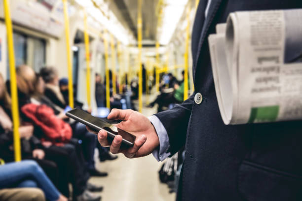 business on the go - commuting in the morning in london - uk travel stock photos and pictures