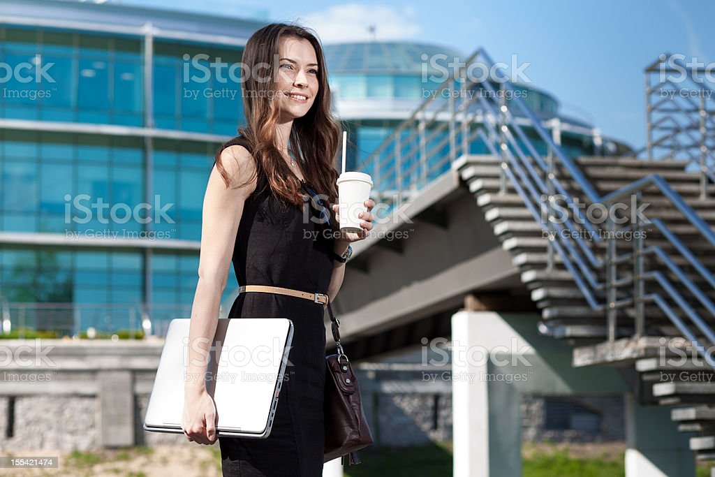 business on the go - young beautiful businesswoman royalty-free stock photo