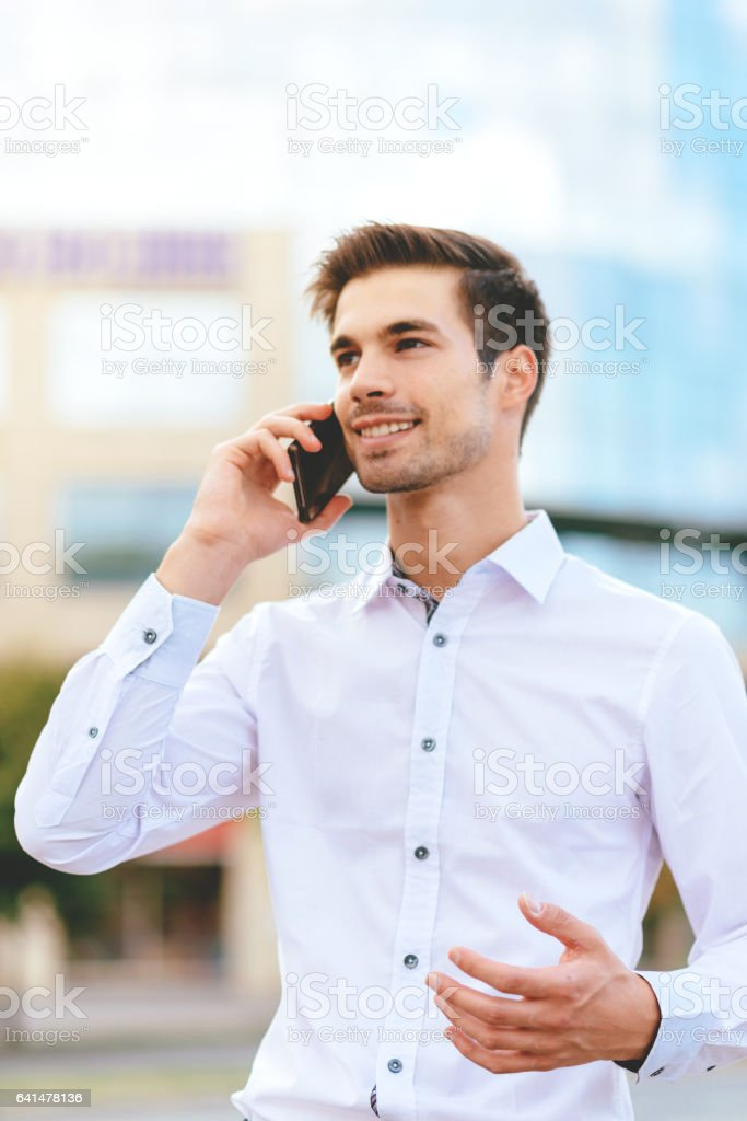 Business on the move - businessman in financial district using smartphone for communication stock photo