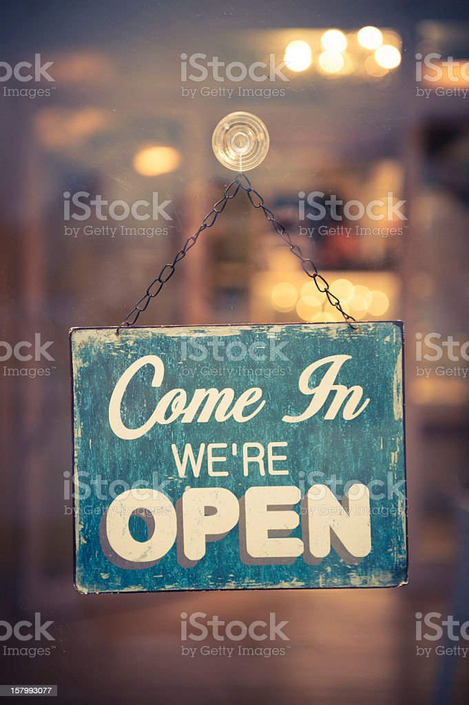 Business Open Sign in window inviting people inside stock photo