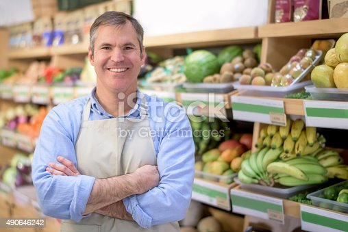 istock Business owner at a grocery store 490646242