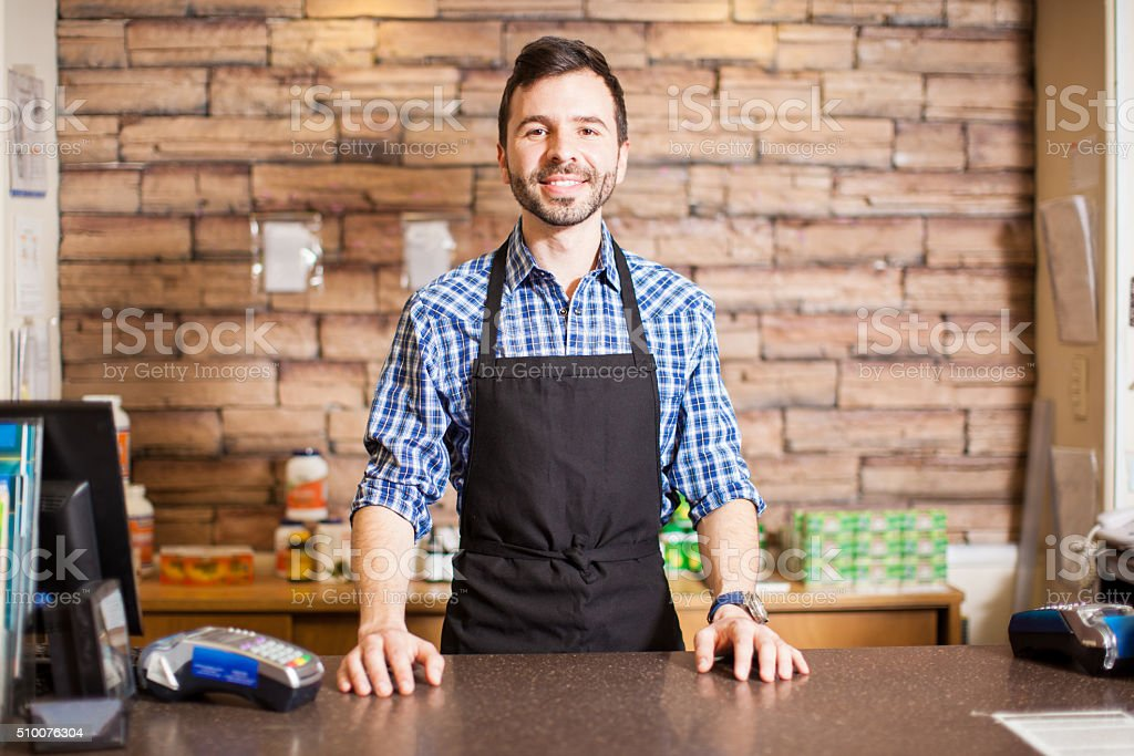 Business owner at the checkout counter stock photo