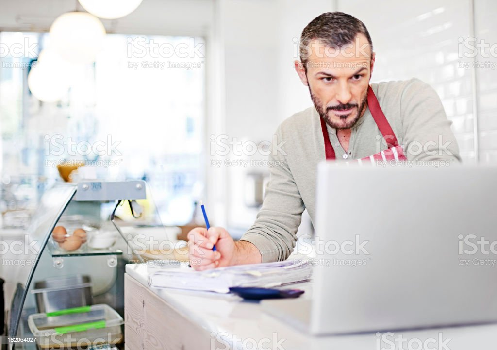 Business owner calculating stock photo