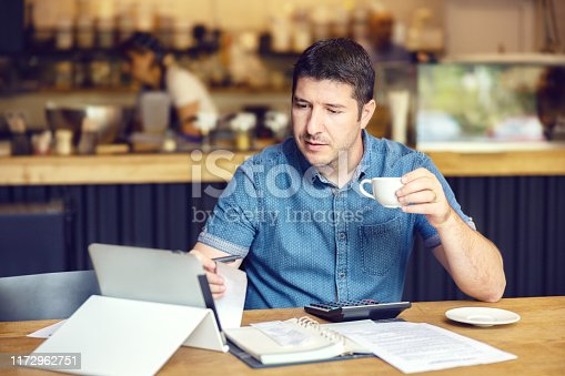 Business owner calculating tax return working on budget and expenses