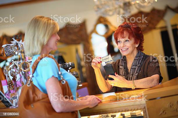 Business Owner Charging A Customers Card In Store Stock Photo - Download Image Now