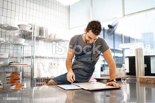 1174436608 istock photo Business owner checking kitchen supplies 1188686915