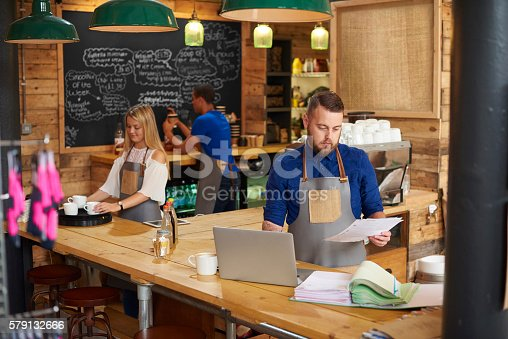 istock business owner checking the books 579132666