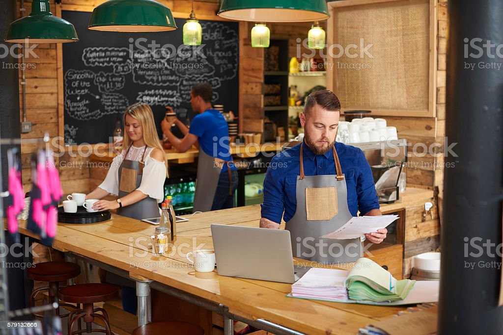 business owner checking the books stock photo