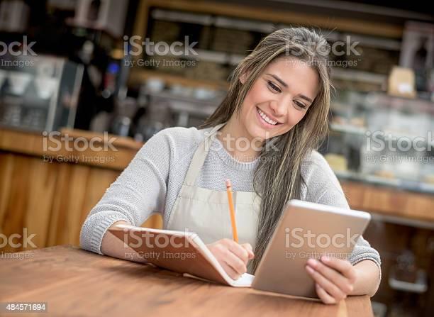 Business owner doing the books at a cafe picture id484571694?b=1&k=6&m=484571694&s=612x612&h=uvapbpktbjtqvqq7gkkosmaafuvbdw0rlpg1grn0wjy=