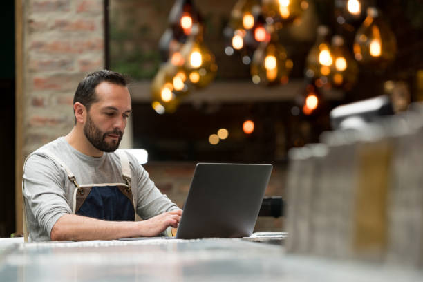 Business owner doing the books at a restaurant stock photo