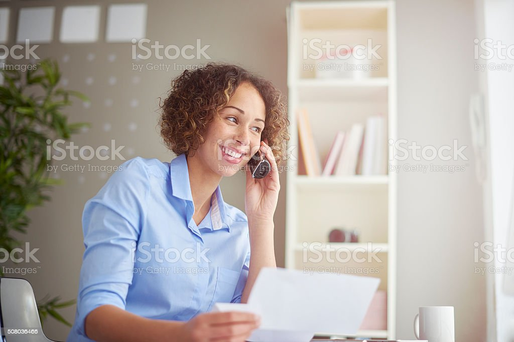 business owner on the phone stock photo