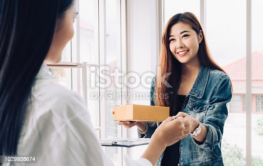 istock Business owner with online shopping concept 1029938674