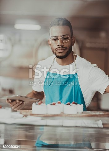 istock Business owner  working in bakery 802050904