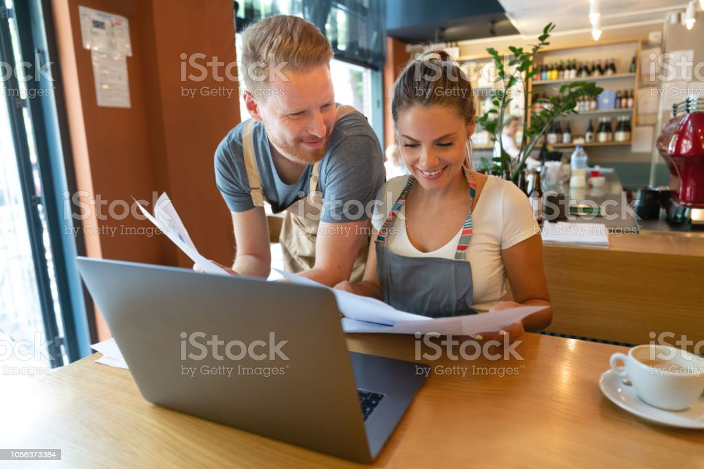 Business Owners Doing The Books At A Restaurant Stock Photo