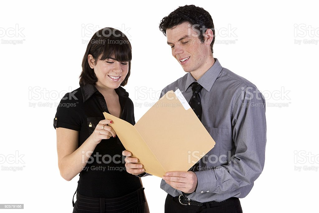 Business pair reading paperwork royalty-free stock photo