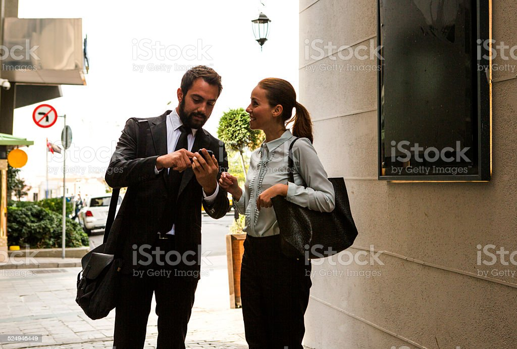 business partner checking meeting agenda in istanbul turkey stock photo