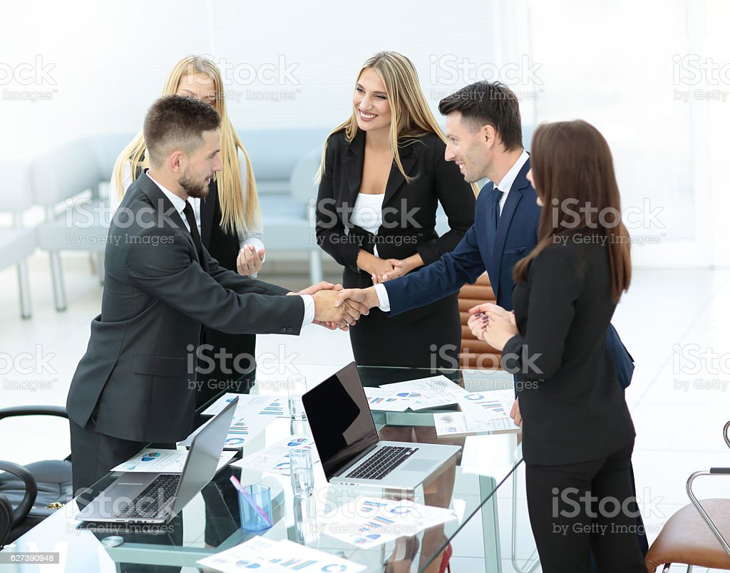 Business Partner Greeting Each Other With Handshake Stock Photo