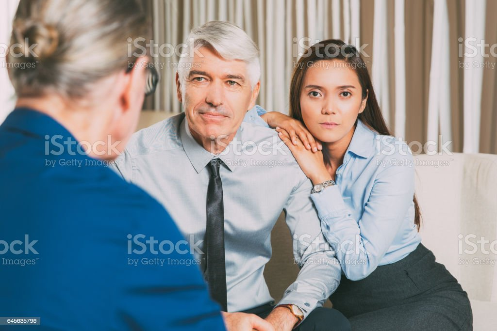 Business Partners and Daughter Talking at Table stock photo