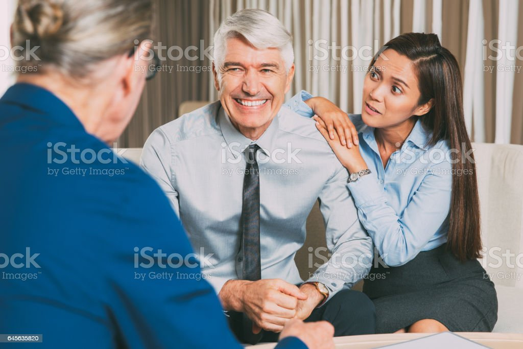 Business Partners and Worried Woman at Table stock photo