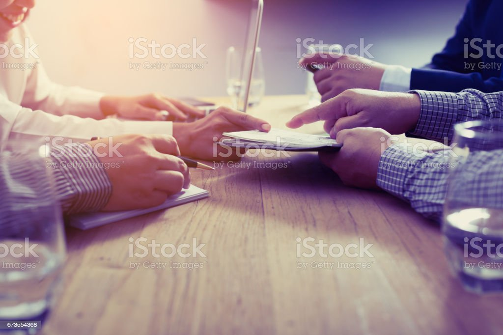 business partners discussing documents and ideas at meeting royalty-free stock photo