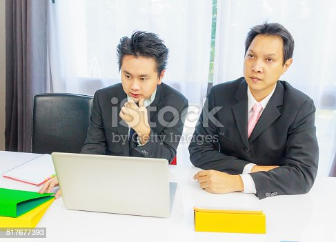 istock business partners discussion at meeting 517677393