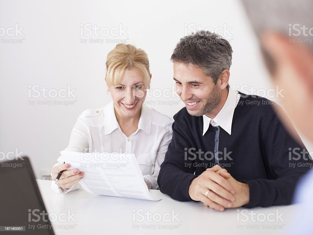 Business partners get a contract royalty-free stock photo